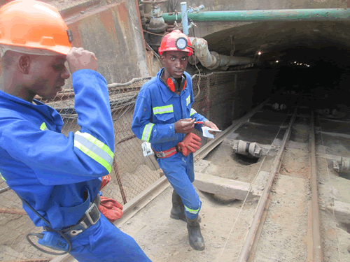 Ministry of Mines Officials examining a shaft at Renco Mine