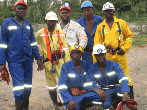 Officials from the Masvingo Provincial Mining Office posing for a photo with Renco Mine Officials